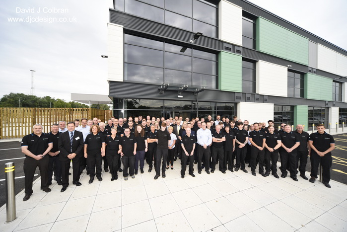 Large group photography outside a new factory