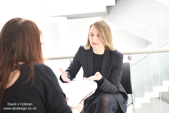 Freelance photographer captures academic interview