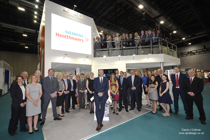 Large staff group photograph at exhibition stand Liverpool