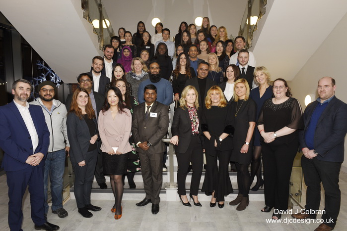 Large staff group photograph at Liverpool John Moores University